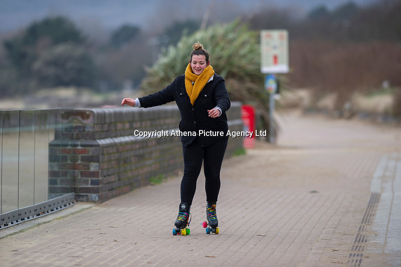 Pictured: A young lady roller blades on Swansea Sea Front, Swansea, Wales, UK. Thursday 31 January 2019<br /> Re: