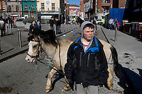 The Smithfield horse market, Dublin, Ireland by James Horan.<br /> The monthly Smithfield Horse market is one of Dublin's oldest traditions. It is a place where kids from deprived areas of the city buy and sell horses. In recent years the Smithfield area has been redeveloped which creates a striking contrast to the horsemarket, The introduction of The Control of Horses Act has effectively outlawed these kids, and the closure of the market is a real possibility.