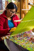 Thimphu, Bhutan.  Woman Weaving.