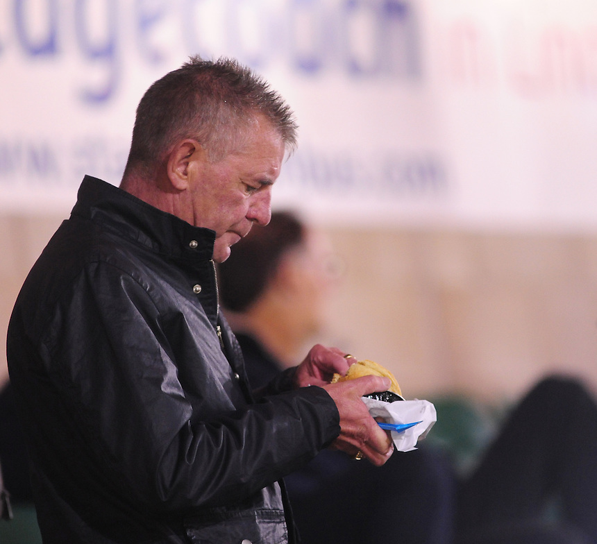A Tamworth fans tucks in to a pie during the game<br /> <br /> (Photo by Chris Vaughan/CameraSport)<br /> <br /> Football - The Skrill Premier - Lincoln City v Tamworth - Tuesady 8th October 2013 - Gelder Group Sincil Bank Stadium - Lincoln<br /> <br /> &copy; CameraSport - 43 Linden Ave. Countesthorpe. Leicester. England. LE8 5PG - Tel: +44 (0) 116 277 4147 - admin@camerasport.com - www.camerasport.com