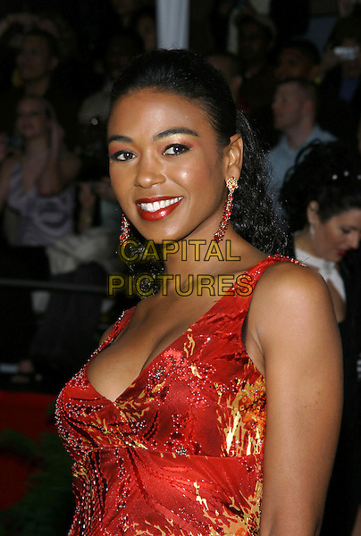ANANDA LEWIS.31st Annual People's Choice Awards held at the Pasadena Civic Auditorium. .January 9th, 2004.Photo Credit: Jacqui Wong/AdMedia..headshot, portrait, red dangling earrings.www.capitalpictures.com.sales@capitalpictures.com.© Capital Pictures.