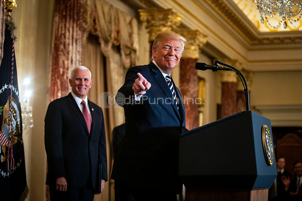 United States President Donald J. Trump speaks beside Vice President Mike Pence, before Mike Pompeo, U.S. secretary of state, is sworn in, at the State Department, in Washington, D.C., U.S., on Wednesday, May 2, 2018. <br /> Credit: Al Drago / Pool via CNP /MediaPunch
