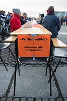 """Mehrere hundert Menschen demonstrierten am Samstag den 8. Februar 2020 in Berlin unter dem Motto """"Wir haben Platz!"""" fuer die Aufnahme minderjaehriger Gefluechteter aus griechischen Fluechtlingslagern. Die Kinder leben dort unter unmenschlichen Bedingungen.<br /> Aufgerufen zu der Demonstration hatte das Buendnis #seebruecke.<br /> Im Bild: Auf der Abschlusskundgebung wurden an einer langen Tafel Stuehle mit Schldern """"Wir haben Platz. Aufnahme jetzt ermoeglichen."""" freigehalten.<br /> 8.2.2020, Berlin<br /> Copyright: Christian-Ditsch.de<br /> [NUR FUER REDAKTIONELLE ZWECKE! Werbung nur auf Anfrage beim Fotografen. Inhaltsveraendernde Manipulation des Fotos nur nach ausdruecklicher Genehmigung des Fotografen. Vereinbarungen ueber Abtretung von Persoenlichkeitsrechten/Model Release der abgebildeten Person/Personen liegen nicht vor. NO MODEL RELEASE! Don't publish without copyright Christian-Ditsch.de, Veroeffentlichung nur mit Fotografennennung, sowie gegen Honorar, MwSt. und Beleg. Konto: I N G - D i B a, IBAN DE58500105175400192269, BIC INGDDEFFXXX, Kontakt: post@christian-ditsch.de<br /> Bei der Bearbeitung der Dateiinformationen darf die Urheberkennzeichnung in den EXIF- und  IPTC-Daten nicht entfernt werden, diese sind in digitalen Medien nach §95c UrhG rechtlich geschuetzt. Der Urhebervermerk wird gemaess §13 UrhG verlangt.]"""