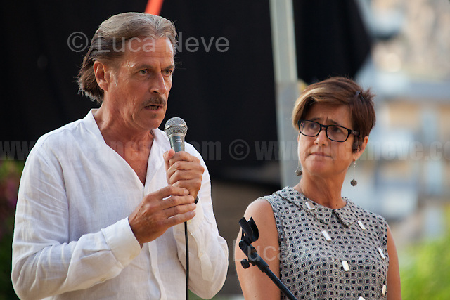 """Stefano e Nunzia Mormile - Relatives of Umberto Mormile, Prisoner educator/teacher killed in Carpiano - Milan - by the Calabrian 'Ndrangheta mafia in 1990.<br /> <br /> Palermo (Sicily - Italy), 19/07/2017. """"Basta depistaggi e omertà di Stato!"""" (""""Stop disinformation & omertá by the State!"""")(1). Public event to commemorate the 25th Anniversary of the assassination of the anti-mafia Magistrate Paolo Borsellino along with five of his police """"scorta"""" (Escorts from the special branch of the Italian police force who protect Judges): Agostino Catalano, Emanuela Loi (The first Italian female member of the police special branch and the first woman of this branch to be killed on duty), Vincenzo Li Muli, Walter Eddie Cosina and Claudio Traina. The event was held at Via D'Amelio, the road where Borsellino was killed. Family members of mafia victims, amongst others, made speeches about their dramatic experiences, mafia violence and unpunished crimes, State cover-ups, silence ('omertá'), and misinformation. Speakers included, amongst others, Vincenzo Agostino & Augusta Schiera, Salvatore & Cristina Catalano, Graziella Accetta, Massimo Sole, Paola Caccia, Luciano Traina, Angela Manca, Stefano Mormile, Ferdinando Imposimato, Judge Nino Di Matteo. The event ended with the screening of the RAI docu-fiction, 'Adesso Tocca A Me' ('Now it's My Turn' - Watch it here: http://bit.ly/2w3WJUX ).<br /> <br /> For more info & a video of the event please click here: http://bit.ly/2eQfNT3 & http://bit.ly/2eQbmrj & http://19luglio1992.com & http://bit.ly/2he8hCj<br /> <br /> (1) 'Omerta' is the term used in Italy to refer to the code of silence used by mafia organisations, as well as the culture of silence that is entrenched in society at large (especially among victims of mafia crimes, as they fear recriminations), about the existence of organised crime and its activities."""