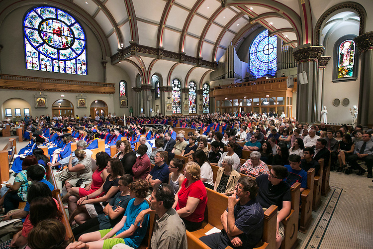 Students and their families gather with faculty and staff at the Saint Vincent de Paul Parish Church on DePaul University's Lincoln Park Campus to participate in a Baccalaureate Mass Friday, June 10, 2016. The event was part of the 118th commencement ceremonies for the Chicago university. (DePaul University/Jamie Moncrief)