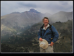 John descending Flattop Mountain with Longs Peak behind.<br /> John leads Rocky Mountain National Park photo tours and Boulder photo workshops. Click the above CONTACT button for inquiries.