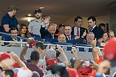 United States President Donald J. Trump acknowledges the crowd during a moment to salute the military during game five of the World Series at Nationals Park in Washington DC on October 27, 2019. The Washington Nationals and Houston Astros are tied at two games going into tonight's game. Among those attending with the president are US Representative John Ratcliffe (Republican of Texas), US Representative Andy Biggs (Republican of Arizona), US Representative Kevin Brady (Republican of Texas), US Senator David Perdue (Republican of Georgia) and US Representative Mark Meadows (Republican of North Carolina).<br /> Credit: Chris Kleponis / Pool via CNP