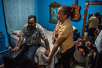 Carlos Saldana and Vicky Delgadillo in the bedroom of their home in Xalapa, Mexico on November 4, 2017. <br /> Photo Daniel Berehulak for The New York Times