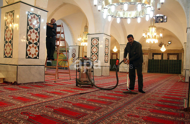 Palestinian men clean the Ibrahimi mosque in the old city of the West Bank city of Hebron on November 15, 2010, ahead of the Muslim holiday of Eid al-Adha or Feast of the Sacrifice, which marks the end of the annual hajj or pilgrimage to Mecca and is celebrated in remembrance of Abraham's readiness to sacrifice his son to God. Photo by Najeh Hashlamoun