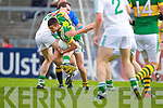Shane Enright clears the lines as Thomas Lee holds him back in the Muster Senior Semi final held in The Gaelic Grounds last Saturday evening.