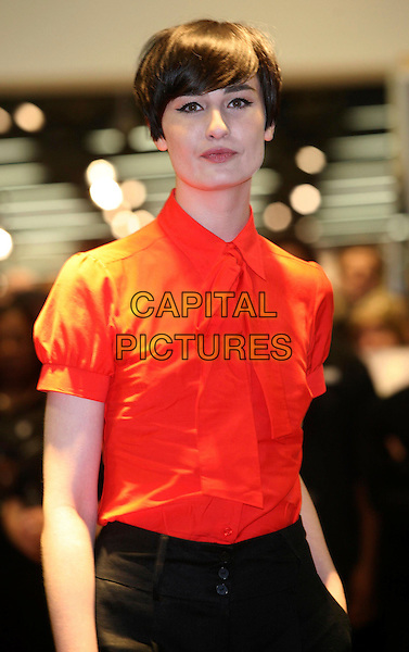 ERIN O'CONNOR.Opens the new M&S store at Colliers Wood, South London, England..May 1st, 2008.M & S Marks & Spencer half length red blouse tie .CAP/DS.©Dudley Smith/Capital Pictures