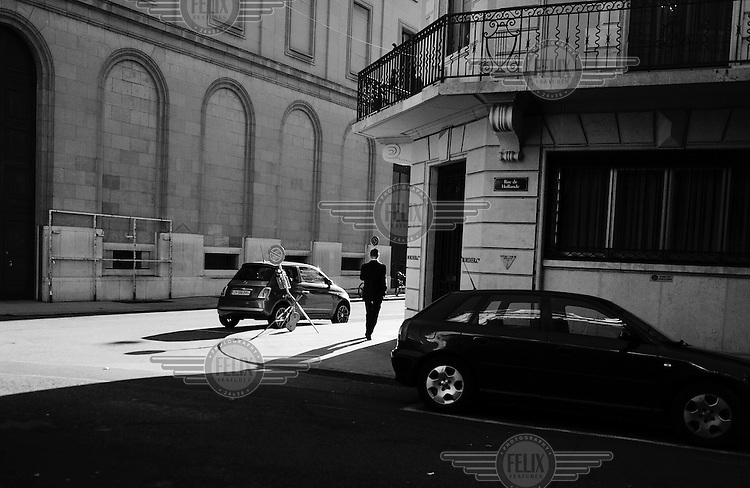 A man in a suit walks past the offices of Bordeir & Cie, a private bank in the Quartier des Banques. /Felix Features