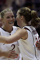 BERKELEY, CA - MARCH 30: Jayne Appel receives congratulations on her 46 point achievement from teammate Kayla Pedersen during Stanford's 74-53 win against the Iowa State Cyclones on March 30, 2009 at Haas Pavilion in Berkeley, California.