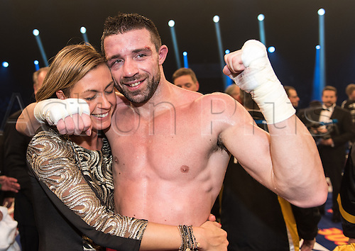 09.01.2016. Offenburg, Germany.  Giovanni De Carolis  of Italy (R) celebrates with his wife Victoria after winning  the WBA super-middleweight world championship bout against Vincent Feigenbutz of Germany (not in picture)  at the Baden-Arena venue in Offenburg, Germany, 9 January 2016.