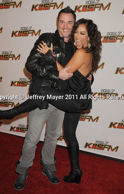 LOS ANGELES, CA - DECEMBER 03: Carrie Ann Inaba and Jesse Sloane attend 102.7 KIIS FM's Jingle Ball at the Nokia Theatre L.A. Live on December 3, 2011 in Los Angeles, California.