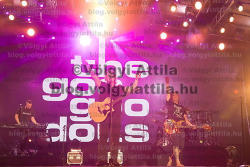 Lead vocalist and guitarist Johnny Rzeznik (C) and bass guitarist and vocalist Robby Takac (R) perform with American rock band Goo Goo Dolls (formerly known as Sex Maggot) at the A38 Stage of Sziget Festival held in Budapest, Hungary on Aug. 13, 2018. ATTILA VOLGYI