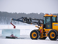 Sweden, SWE, Kiruna, 2010Mar30: Big blocks of ice are being cut and lifted out from the frozen Torne Älv River with heavy equipment at the Jukkasjärvi icehotel.
