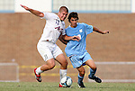 06 September 2009: Evansville's Tom Irvin (13) and UNC's Michael Farfan (19). The University of North Carolina Tar Heels defeated the Evansville University Purple Aces 4-0 at Fetzer Field in Chapel Hill, North Carolina in an NCAA Division I Men's college soccer game.
