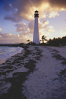 Cape Florida Lighthouse rises above the Atlantic Ocean shore at sunset, Cape Florida Light, Key Biscayne State Park, Dade County, Florida