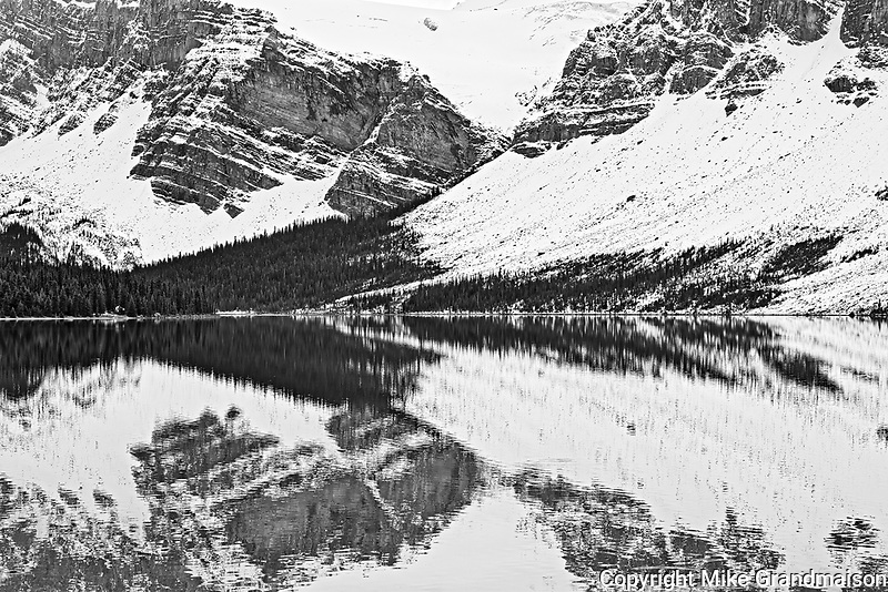 Crowfoot Mountain in the <br /> Canadian Rockies reflected in Bow Lake. Icefields Parkway.<br />