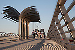 People Walking along the Harbour Wall Pier Promenade Walk in Alicante, Spain
