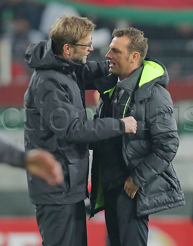 18.02.2016. Augsburg, Germany. UEFA Europa League football. Augsburg versus Liverpool FC.  Markus WEINZIERL, FCA Trainer greets Juergen KLOPP Liverpool Trainer pre-game