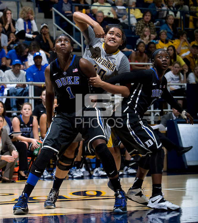 Justine Hartman of California and Elizabeth Williams of Duke in action during the game at Haas Pavilion in Berkeley, California on November 10th, 2013.    Duke defeated California, 70-58.