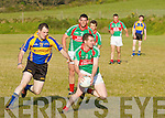 Bernard Kelly for St Michaels /Foilmore under pressure defending his lines from attacking Kenmare's Mike Tim O'Sullivan.