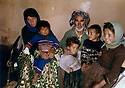 Iran 1982 .In the village of Ghalve, a Kurdish family who lost three children in a bombing  .Iran 1982 .Au village de Ghalve, une famille kurde ayant perdu 3 enfants au cours d'un bombardement .