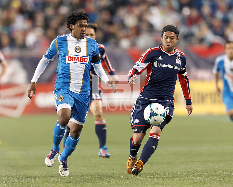 New England Revolution midfielder Lee Nguyen (24) tracks down a pass as Philadelphia Union defender Sheanon Williams (25) closes.In a Major League Soccer (MLS) match, the New England Revolution (blue/red) defeated Philadelphia Union (blue/white), 2-0, at Gillette Stadium on April 27, 2013.