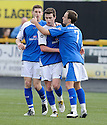 Grant Gallagher (centre) celebrates after he scores Stranraer's goal.