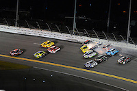12-13 February, 2016, Daytona Beach, Florida, USA<br /> Denny Hamlin, FedEx Express Toyota Camry races away for the win as Matt Kenseth, Dollar General Toyota Camry, Martin Truex Jr, Furniture Row Toyota Camry,Casey Mears, Jamie McMurray, Brad Keselowski, Greg Biffle and Danica Patrick crash in turn one on the final lap.<br /> ©2016, F. Peirce Williams