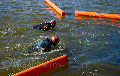 01 JUN 2013 - MADRID, ESP - Competitors leave the water at the end of their swim during the WTP Agemaster race in Casa de Campo in Madrid, Spain (PHOTO (C) 2013 NIGEL FARROW)