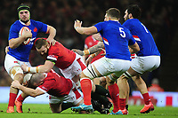 Gregory Alldritt of France is tackled by Ken Owens and Jake Ball of Wales during the Guinness Six Nations Championship Round 3 match between Wales and France at the Principality Stadium in Cardiff, Wales, UK. Saturday 22 February 2020