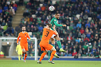 16th November 2019; Windsor Park, Belfast, County Antrim, Northern Ireland; European Championships 2020 Qualifier, Northern Ireland versus Netherlands; Josh Magennis of Northern Ireland wins the header against Netherland's Matthijs de Ligt - Editorial Use