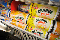 Cans of store brand frozen orange juice are seen in a supermarket freezer case on Thursday, January 12, 2012. Orange juice futures hit a record high because of fears that the government will ban oj imports from Brazil due to traces of the fungicide carbendazim found in some incoming shipments. The FDA is checking all incoming shipments for the illegal pesticide. (© Richard B. Levine)