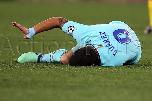 10th April 2018, Stadio Olimpico, Rome, Italy; UEFA Champions League football, quarter final, second leg; AS Roma versus FC Barcelona; Luis Suarez of Barcelona lies on the field after being injured