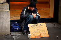 United States, New York, November 29, 2011..A homeless begs for money at downtown Manhattan in New York, November 29, 2011. VIEWpress / Eduardo Munoz Alvarez..Council plans to file a lawsuit to stop Mayor Michael Bloomberg's administration from implementing a new homeless-shelter policy. .Local Media Report.