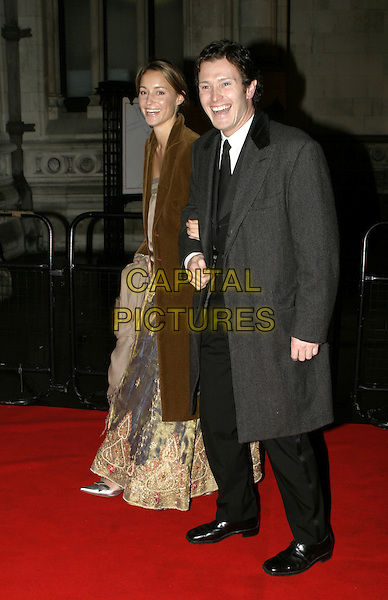 NICK MORAN.Great Britons 2004  at The Royal Courts Of Justice..January 27th, 2005.full length, arms linked, grey, gray coat, jacket.www.capitalpictures.com.sales@capitalpictures.com.© Capital Pictures.