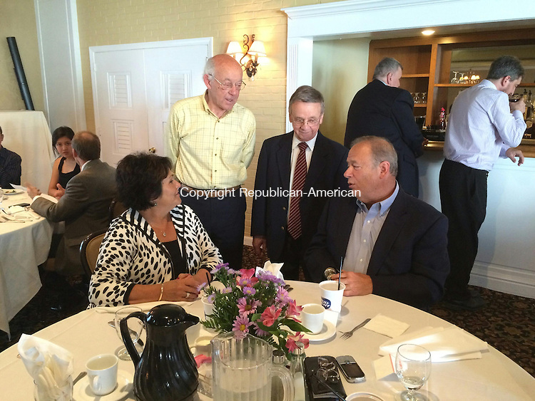 "TORRINGTON, CT- 19 May 2015- 051915BJ01-- Raymond ""Brook"" Colangelo, former co-owner of Dick's Restaurant, second from right, talks with members of the restaurant's scholarship committee, including Richard L. Zaharek, right, David J. Frauenhofer, and Adele Zaharek. While the restaurant closed in 2008, the scholarship fund continues to provide awards for three Torrington High School students.  Bruno Matarazzo Jr. Republican-American"