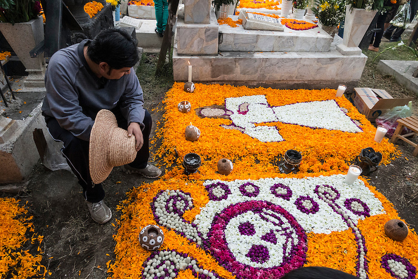 """Mexicans visiting their dead relatives, lighting candles, lighting incense and decorating their graves for the Day of the Dead festival in San Andre de Mixquic shot as part of the Sony RX100 III """"Celebrate The Streets"""" series."""