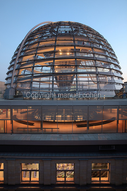 The glass dome of the Reichstag building, seat of the German parliament and meeting place of the Bundestag, originally opened 1894 but refurbished by Norman Foster 1990-99, Berlin, Germany. The dome is open to the public and has panoramic views over the city. Access is by 2 steel spiralling ramps in double-helix form and the debating chamber of the Bundestag can be viewed below the dome. The dome symbolises that the people of the reunified Germany are above the government. Picture by Manuel Cohen