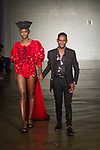 Fashion designer walks runway with model at the close of his TVL collection fashion show,  for Free Fashion Week at Cope NYC, on October 10, 2019, during Fashion Week Brooklyn Spring Summer 2020.