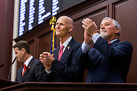 TALLAHASSEE, FLA. 1/12/16-Gov. Rick Scott, center, is joined by Sen. Garrett Richter, R-Naples, right and Senate President Andy Gardiner, R-Orlando, left as they recognizes his wife Ann during the state of the state address Tuesday at the Capitol in Tallahassee.<br /> <br /> COLIN HACKLEY PHOTO