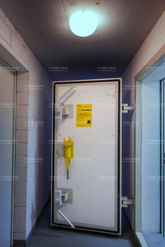 Switzerland. Canton Zürich. Andelfingen. Entrance door to fallout shelter under block of 9 apartments. Underground bunker built to accommodate 36 people living with flats above. The bunker was built by company Andair AG who have built over 30'000 bunkers in Switzerland. 5.02.2019 © 2019 Didier Ruef