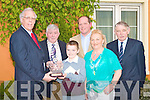 HANDLER AWARD: T.J. Maunsell being presented with his All Ireland U12 YMA Calf Handler Championship trophy by Junior Agriculture Minster Tony Killeen at the launch of the 60th anniversary of the Kerry County Show in the Meadowlands hotel on Friday l-r: Junior Agriculture Minster Tony Killeen, John Browne (National Chairman of the Irish Shows Association), T.J. and Michael Maunsell, Mary Barry (Secretary KCS) and Robert Groves (Chairman KCS).