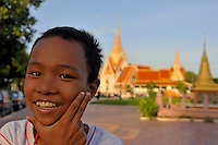 Smiling boy portrait by the Royal Palace at sunset, Phnom Penh, Cambodia