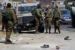 Israeli soldiers are seen at the site of a stabbing attack by a Palestinian man next to the entrance of the al-Arub refugee camp near the city of Hebron in the Israeli-occupied West Bank on July 18, 2016 in which two soldiers were wounded. The Palestinian assailant was wounded by a gunshot from one of the attacked soldiers and evacuated to a hospital, the Israeli army said. Photo by Wisam Hashlamoun
