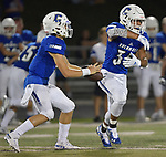 Columbia quarterback Nic Horner (left) fakes a handoff to running back Donovan Bieber. Columbia played Mascoutah on Saturday August 31, 2019 in a football game that was never started on Friday night due to bad storms.<br /> Tim Vizer/Special to STLhighschoolsports.com