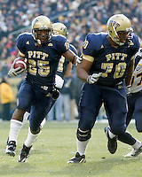 November 28, 2008. Pitt running back LeSean McCoy (25) follows the block of Dominic Williams (70).  The Pitt Panthers defeated the West Virginia Mountaineers 19-15 on November 28, 2008 at Heinz Field, Pittsburgh, Pennsylvania.